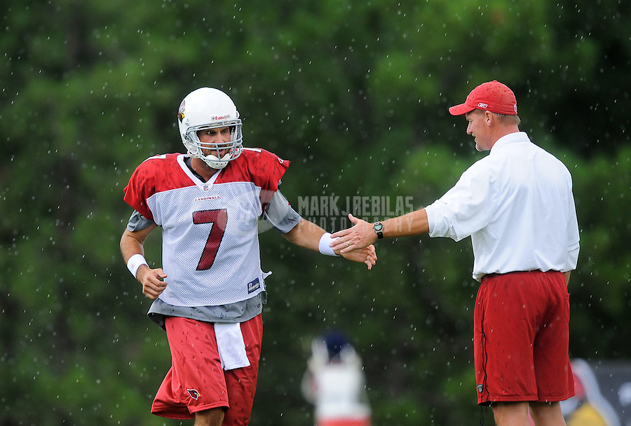 Jul 31, 2009; Flagstaff, AZ, USA; Arizona Cardinals quarterback (7) Matt Leinart high fives head coach Ken Whisenhunt during training camp on the campus of Northern Arizona University. Mandatory Credit: Mark J. Rebilas-