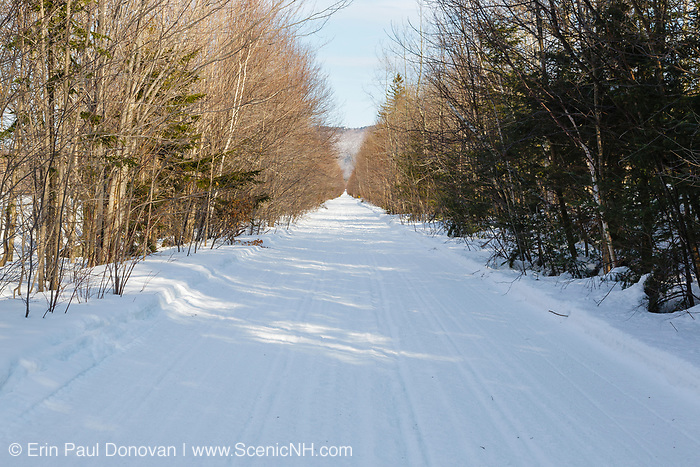 Haystack Road in the White Mountains of New Hampshire during the winter months. This is a seasonal road used during as winter by snowmobiles.