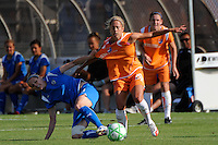Kelly Smith (10) of the Boston Breakers grabs ahold of Kacey White (20) of Sky Blue FC. Sky Blue FC defeated the Boston Breakers 1-0 during a Women's Professional Soccer match at Yurcak Field in Piscataway, NJ, on July 4, 2009.