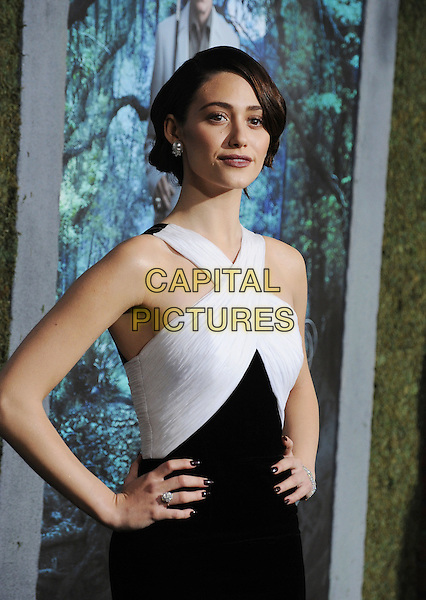 """Emmy Rossum.arriving at the Los Angeles premiere of """"Beautiful Creatures"""" at TCL Chinese Theatre in Hollywood, California, USA, .February 6th, 2013..half length black smiling white cross over  hands on hips dress .CAP/ROT/TM.©Tony Michaels/Roth Stock/Capital Pictures"""