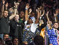 NWA Democrat-Gazette/CHARLIE KAIJO Walmart Associates react during the Walmart shareholders meeting, Friday, June 7, 2019 at the Bud Walton Arena in Fayetteville.