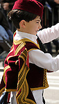 Greek Parade in New York City. A boy in a red, white, and gold costume in the Greek Parade in New York City.