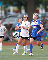 Boston Breakers midfielder Joanna Lohman (11) tracks loose ball. In a National Women's Soccer League (NWSL) match, Boston Breakers (blue) defeated Portland Thorns FC (white/black), 2-1, at Dilboy Stadium on August 7, 2013.