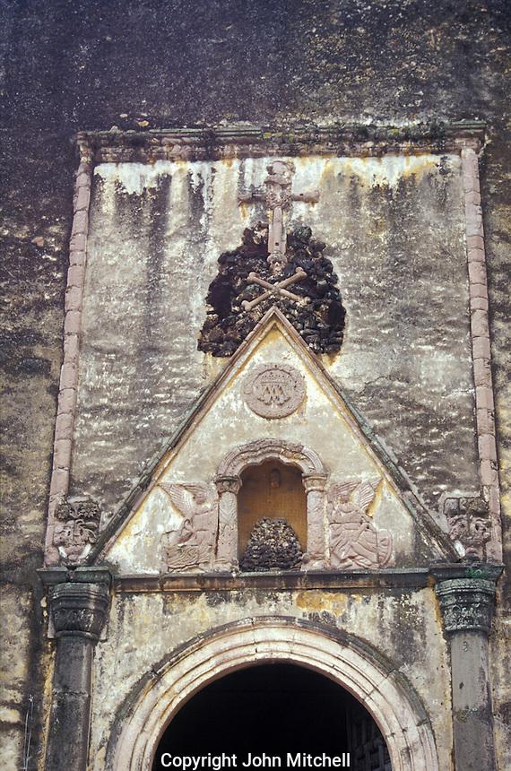 Skull and crossbones, symbol of the Franciscan order, above the entrance to  the 16th-century cathedral or Templo de la Asuncion de Maria in Cuernavaca, Morelos, Mexico.