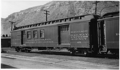#65 RPO &amp; baggage combine car at Durango.  3/4 view.<br /> D&amp;RGW  Durango, CO