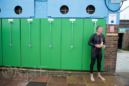 28 SEP 2013 - LONDON, GBR - Rod Elder recovers under a shower after finishing the 7.3 mile swim of the Enduroman 2013 Lands End to London to Dover ultra triathlon at Charlton Lido in London, Great Britain (PHOTO COPYRIGHT © 2013 NIGEL FARROW, ALL RIGHTS RESERVED)
