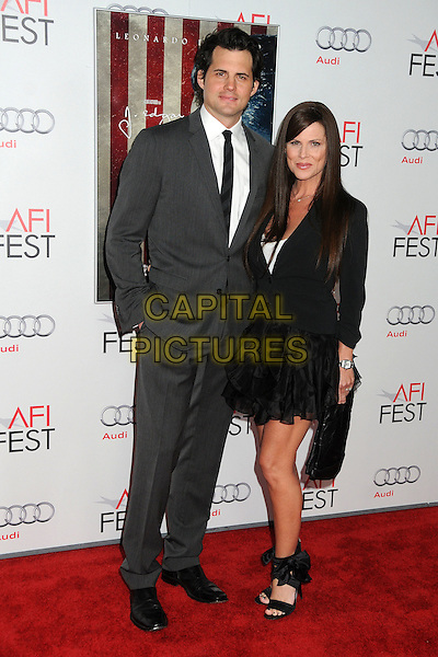 "Kristoffer Polaha and Julianne Morris.AFI Fest 2011 Opening Night Gala Premiere of ""J. Edgar"" held at Grauman's Chinese Theatre, Hollywood, California, USA..November 3rd, 2011.full length suit shirt dress blazer black grey gray white tie.CAP/ADM/BP.©Byron Purvis/AdMedia/Capital Pictures."