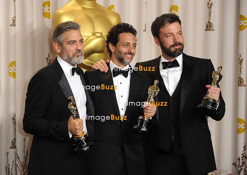 (left to right) George Clooney, Grant Heslov and Ben Affleck with the Oscar for Best Picture for Argo at the 85th Academy Awards at the Dolby Theatre, Los Angeles.
