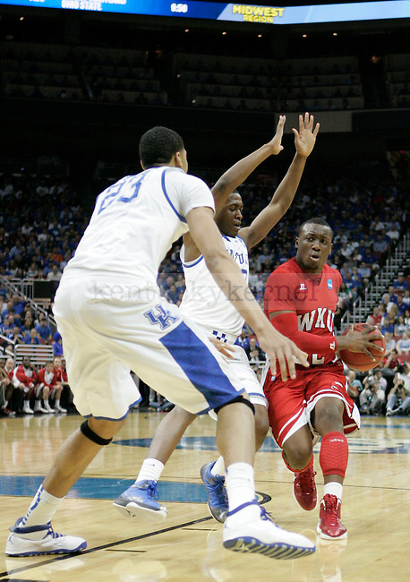 T.J. Price drives the ball in the University of Kentucky versus Western Kentucky University game in the second round of the NCAA Tournament, in the KFC Yum! Center, on Thursday, March 15, 2012 in Louisville, Ky.  Photo by Latara Appleby | Staff ..