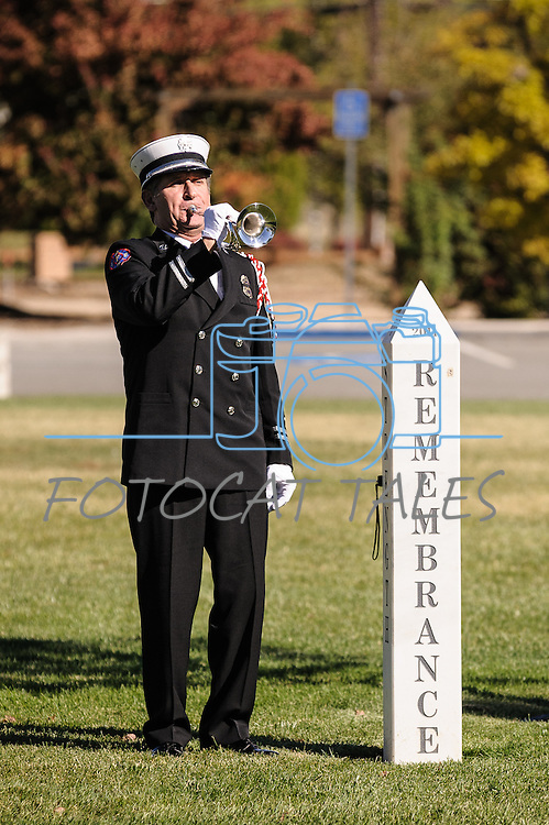 Bob Masters from the Reno Fire Department Honor Guard plays Taps during this year's Memorial induction ceremony at Mills Park in Carson City, Nevada.  Richard Chrzanowski of the Carson City FD and Jerry Harper of the Clark County FD were added to names of fallen firefighters at the Memorial.