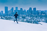 A runner with Calgary downtown in the background, Alberta, Canada