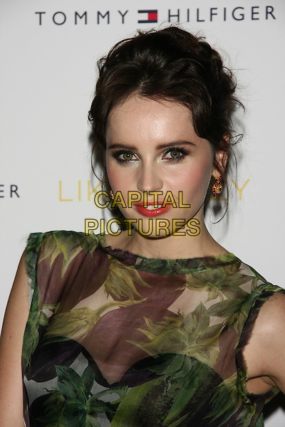 "Felicity Jones.The New York Premiere of ""Like Crazy"" at the Landmark Sunshine Cinema, New York, NY, USA..October 18th, 2011.headshot portrait green brown sheer sleeveless leaves leaf print hair up.CAP/LNC/TOM.©TOM/LNC/Capital Pictures."