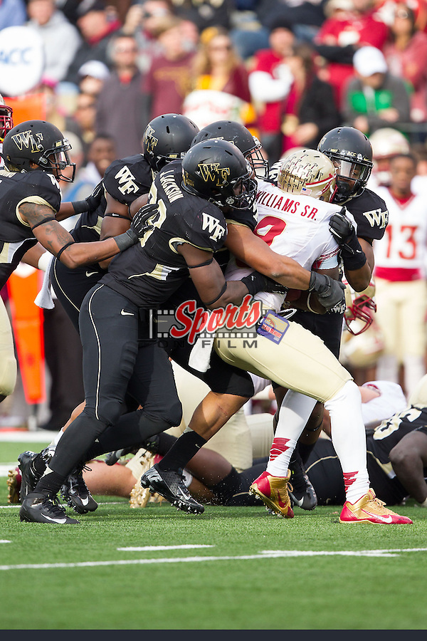 Karlos Williams (9) of the Florida State Seminoles is hit by Justin Jackson (39) of the Wake Forest Demon Deacons at BB&T Field on November 9, 2013 in Winston-Salem, North Carolina.  The Seminoles defeated the Demon Deacons 59-3.    (Brian Westerholt/Sports On Film)