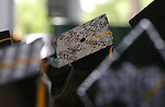 Graduates show off their cap decorations at the 45th annual Western Nevada College Commencement ceremony in Carson City, Nev., on Monday, May 23, 2016. A record 556 graduates received 598 degrees.<br />