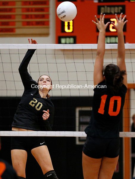 Watertown, CT- 28 October 2015-102815CM05-  Woodland's Carla Piccolo goes up for the shot as Watertown's Britt Jacovich jumps up to defend during their NVL matchup in Watertown on Wednesday.     Christopher Massa Republican-American