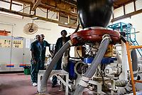 RWANDA, Kigali, plastic recycling at company Ecoplastics, extruder machine KABRA which is generating the plastic liquid from which the plastic foils are manufactured
