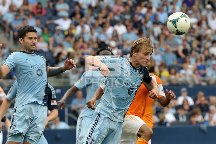 Seth Sinovic (15) defender Sporting KC heads the ball away..Sporting Kansas City and Houston Dynamo played to a 1-1 tie at Sporting Park, Kansas City, Kansas.