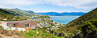 Panoramic Photo of a House with a Seaview of Tata Beach, Golden Bay Area, South Island, New Zealand. This panoramic photo shows Tata Beach, a stunning beach located in the Golden Bay Region of South Island, New Zealand. The golden sand and turquoise water make is a truely beautiful beach to visit.