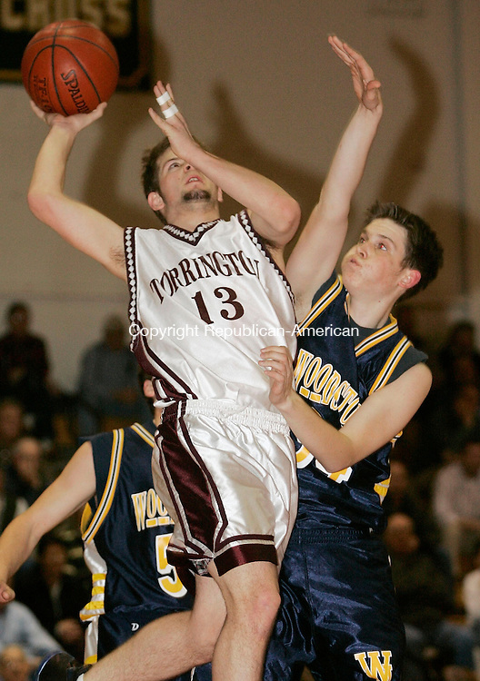 TORRINGTON, CT - 14 MARCH 2005 - 031405JS04--Torrington's Chris Morin (13) puts up a shot over Woodstock's Chris Dunn (54) during their CIAC tournament at Torrington High School  --Jim Shannon Photo --TTorrington High School; Chris Morin; Chris Dunn, Woodstock are CQ