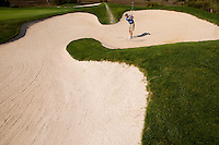 A golfer hits the ball from a sand trap in Charleston, SC.