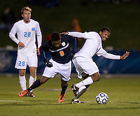 Jordan McCrary (9) of North Carolina fights for the ball with Darius Madison (9) of Virginia during the game at the Maryland SoccerPlex in Germantown, MD. North Carolina defeated Virginia on penalty kicks after playing to a 0-0 tie in regulation time.  With the win the Tarheels advanced to the finals of the ACC men's soccer tournament.