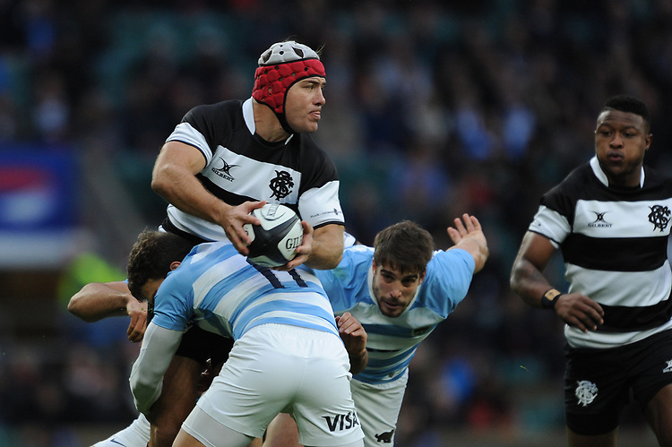 Schalk Brits of Barbarians (Stormers & South Africa) offloads as he is tackled by Ramiro Moyano of Argentina during the Killik Cup match between the Barbarians and Argentina at Twickenham Stadium on Saturday 1st December 2018 (Photo by Rob Munro/Stewart Communications)