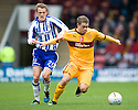 KILMARNOCK'S DEAN SHIELS TRIES TO PULL BACK MOTHERWELL'S NICKY LAW