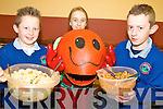 ORANGE: Having fun at the Healthy Eating Week at Knockngree school last week were l-r: Tim Cronin, Ellen O'Leary (with 'Mrs Orange'), John Fintan Daly.