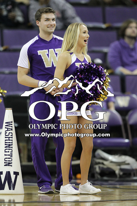 SEATTLE, WA - DECEMBER 18: Washington cheerleader Annie Millspaugh entertained fans during a timeout break against Western Michigan.  Washington won 92-86 over Western Michigan at Alaska Airlines Arena in Seattle, WA.