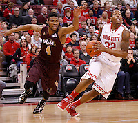 Ohio State Buckeyes guard Lenzelle Smith Jr. (32) is guarded by Louisiana-Monroe Warhawks guard R.J. McCray (4) during Friday's NCAA Division I basketball game at Value City Arena in Columbus on December 27, 2013. Ohio State led the game at halftime, 41-20. (Barbara J. Perenic/The Columbus Dispatch)