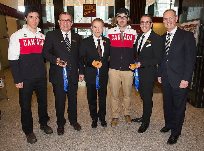 Paralympians Graham Nishikawa, left, and Robin Femy, centre, poses with CIBC branch manager Denis Charbonneau, 2nd left, region head for eastern Canada Sylvain Vinet, CIBC general manager Michel Lachapelle, 2nd right, and Daniel Poudrier CIBC district VP at an event in the CIBC Rene Levesque branch in Montreal, Friday, March 28, 2014. Photo: Graham Hughes/CIBC