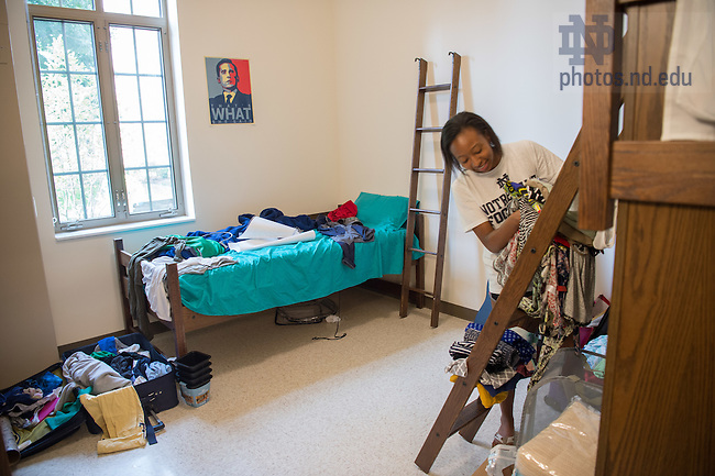 August 19, 2016; First year student Irla Atanda from Jacksonville, FL sorts her things in her Flaherty Hall dorm room on move-in day of Welcome Weekend 2016. (Photo by Matt Cashore/University of Notre Dame)