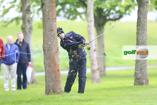 Russell Knox (SCO) plays his 2nd shot from the trees on the 17th hole during Thursday's Round 1 of the 2016 Dubai Duty Free Irish Open hosted by Rory Foundation held at the K Club, Straffan, Co.Kildare, Ireland. 19th May 2016.<br /> Picture: Eoin Clarke | Golffile<br /> <br /> <br /> All photos usage must carry mandatory copyright credit (&copy; Golffile | Eoin Clarke)