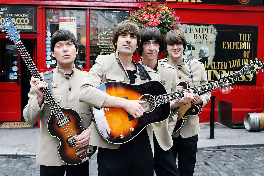 NO REPRO FEE. 4/8/2010.The Story of the Beatles. Ringo, John, George and Paul are pictured in Temple Bar taking a break from rehearsals of Get Back: The Story of the Beatles at the Olympia Theatre, Dublin. The Fab Four will play from Wednesday 4th of August until Sunday 8th of August for a limited run. Tickets from EUR25 including booking fee on sale now. For more info contact Sabrina Sheehan sabrinasheehan@mcd.ie. Picture James Horan/Collins Photos
