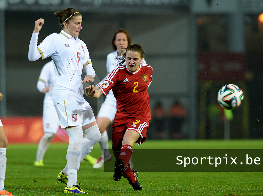 20151130 - LEUVEN ,  BELGIUM : Belgian Davina Philtjens (r) pictured in a duel with Serbian Nikoleta Nikolic (left)  during the female soccer game between the Belgian Red Flames and Serbia , the third game in the qualification for the European Championship in The Netherlands 2017  , Monday 30 November 2015 at Stadion Den Dreef  in Leuven , Belgium. PHOTO DAVID CATRY