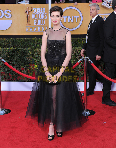 Anne Hathaway (wearing Giambattista Valli).Arrivals at the 19th Annual Screen Actors Guild Awards at the Shrine Auditorium in Los Angeles, California, USA..27th January 2013.SAG SAGs full length dress black sleeveless sheer tulle clutch bag bodice embroidered skirt .CAP/DVS.©DVS/Capital Pictures.