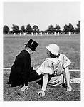 Eton boy & mother by cricket pitch, June, 1933