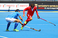 China's captain Du Chen skips through a challenge from Korea's Lee Jungjun  during the Hockey World League Semi-Final Pool A match between China and Korea at the Olympic Park, London, England on 17 June 2017. Photo by Steve McCarthy.