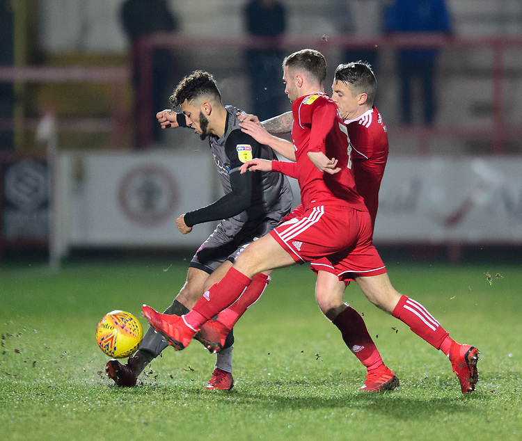 Lincoln City's Kellan Gordon vies for possession with Accrington Stanley's Jordan Clark<br /> <br /> Photographer Andrew Vaughan/CameraSport<br /> <br /> The EFL Checkatrade Trophy Second Round - Accrington Stanley v Lincoln City - Crown Ground - Accrington<br />  <br /> World Copyright &copy; 2018 CameraSport. All rights reserved. 43 Linden Ave. Countesthorpe. Leicester. England. LE8 5PG - Tel: +44 (0) 116 277 4147 - admin@camerasport.com - www.camerasport.com