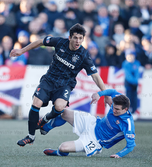 Anestis Argyriou gets a sore one from Montrose's Scott Johnston