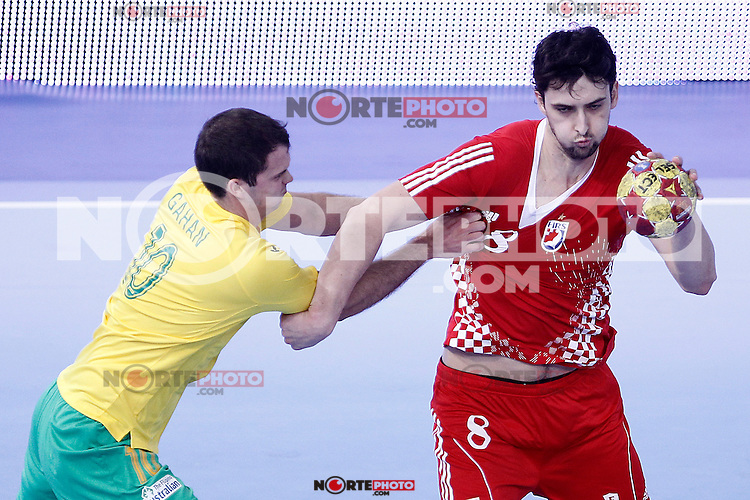 Croatia's Damir Bicanic (r) and Australia's Caleb Gahan during 23rd Men's Handball World Championship preliminary round match.January 12 ,2013. (ALTERPHOTOS/Acero)