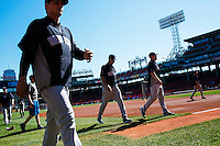 BOSTON, MASS. - SEPT. 28, 2014: Derek Jeter and other Yankees return the dugout after stretching before the New York Yankees and Boston Red Sox play at Fenway Park. The game is last game of Derek Jeter's career. M. Scott Brauer for The New York Times