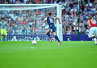 August 09, 2012: United States' Carli Lloyd on her way to score the first goal of Football Final match against Japan at the Wembley Stadium on day thirteen in Wembley, England. USA defeat Japan 2-1 to win it's third consecutive Olympic gold medal in women's soccer. ..