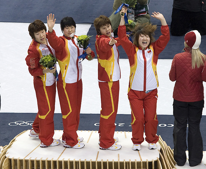 February 24 2010: Vancouver 2010  Olympics, The Chinese women's short track relay team celebrates the gold medal win at the Pacific Coliseum during the 2010 Vancouver Olympics.