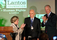 President Shimon Peres of Israel accepts the Lantos Human Rights Prize bestowed by the Lantos Foundation for Human Rights in honor of the late Congressman Tom Lantos (Democrat of California). From left to right: Annette Lantos, wife of the late Congressman and Chair, Lantos Foundation Board of Trustees; President Peres, and United States Vice President Joe Biden.<br /> Credit: Ron Sachs / CNP /MediaPunch