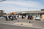 Mar. 13, 2011 - Ibaraki, Japan - People line up in front of a 7-11 in Hitachinaka City to buy supplies two days after the 8.9 magnitude earthquake struck followed by a tsunami that hit the north-eastern region. The death toll is currently unknown with casualties that may run well into the thousands.