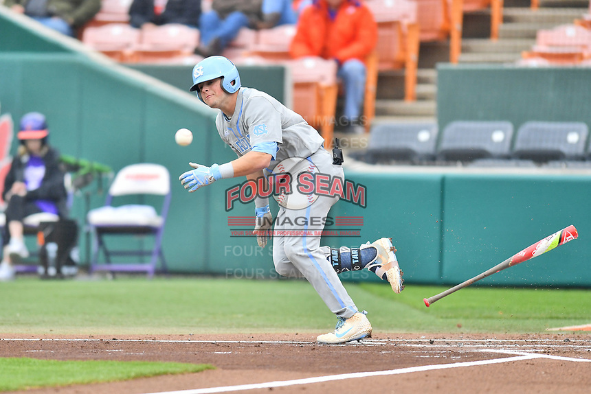 North Carolina Tar Heels third baseman Ashton McGee (5) lays down a bunt during a game against the Clemson Tigers at Doug Kingsmore Stadium on March 9, 2019 in Clemson, South Carolina. The Tigers defeated the Tar Heels 3-2 in game one of a double header. (Tony Farlow/Four Seam Images)