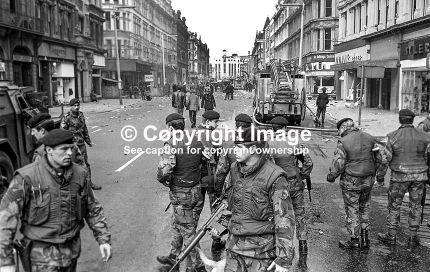 British soldiers seal off Royal Avenue, Belfast, N Ireland, following an explosion outside the former Grand Central Hotel in March 1974. The hotel  became even more of a target after it was taken over by the British Army as as a base and billet. 197403000216a..© Victor Patterson, 54 Dorchester Park, Belfast, N Ireland. Tel: +44 2890661296; Mobile: +44 7802 353836; Emails: victorpatterson@me.com & victorpatterson@gmail.com; www.victorpatterson.com