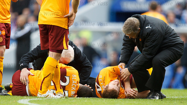Nick Blackman and Mark Reynolds down and getting medical attention as the play is stopped