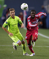 Seattle Sounders FC defender Jeff Parke Chicago Fire forward Patrick Nyarko during play between the Seattle Sounders FC and the Chicago Fire in the U.S. Open Cup Final at CenturyLink Field in Seattle Tuesday October 4, 2011. Seattle won the game 2-0 to win its third U.S. Open Cup.